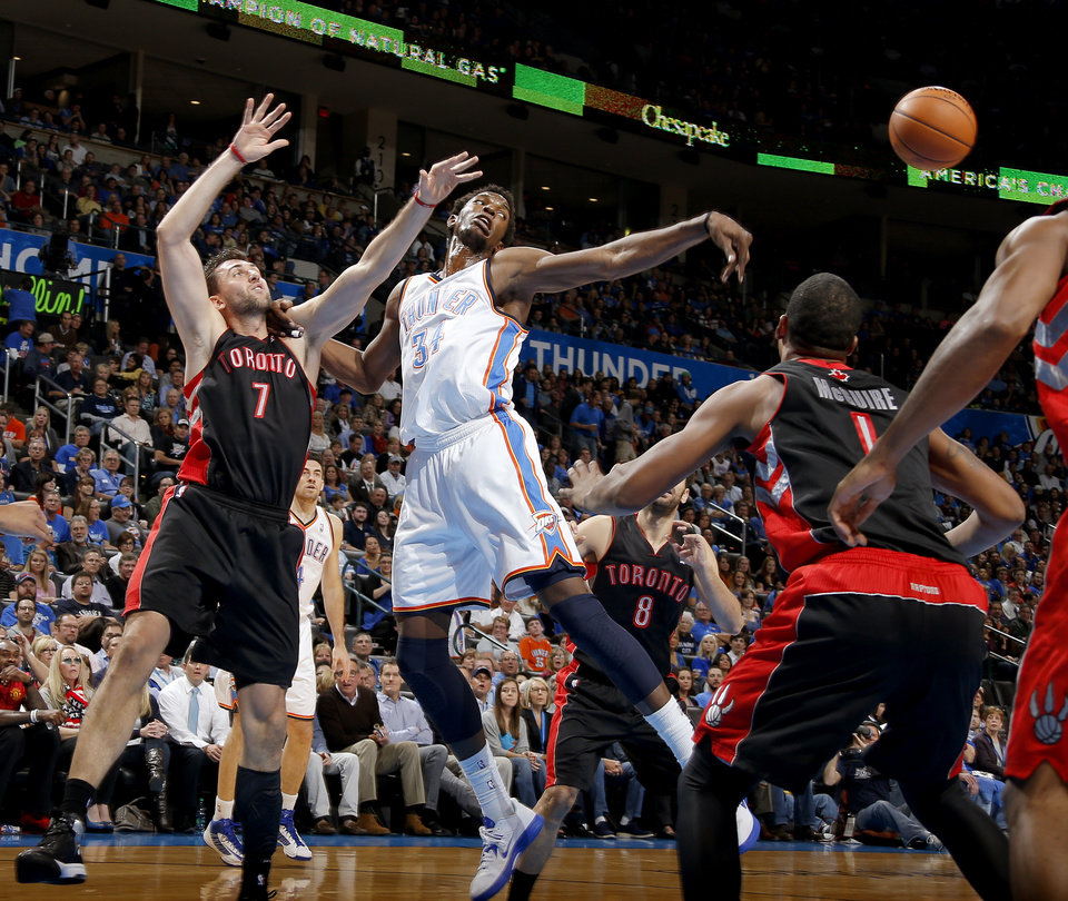 Oklahoma City\'s Hasheem Thabeet (34) passes the ball beside Toronto\'s Andrea Bargnani (7) during an NBA basketball game between the Oklahoma City Thunder and the Toronto Raptors at Chesapeake Energy Arena in Oklahoma City, Tuesday, Nov. 6, 2012. Tuesday, Nov. 6, 2012. Photo by Bryan Terry, The Oklahoman