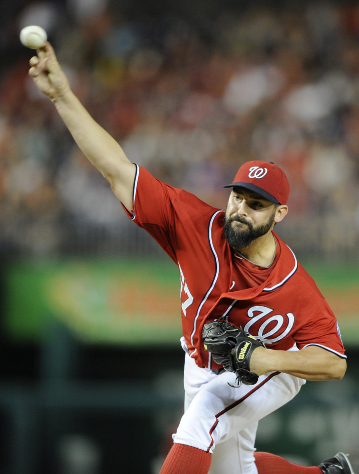 Photo - Washington Nationals starting pitcher Tanner Roark delivers to the Milwaukee Brewers during the seventh inning of a baseball game, Saturday, July 19, 2014, in Washington. The Nationals won 8-3. (AP Photo/Nick Wass)