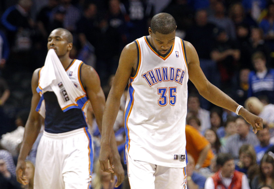 Photo - Oklahoma City 's Kevin Durant (35) and Serge Ibaka (9) react after their loss following the NBA game between the Oklahoma City Thunder and the Los  Angeles Clippers at the Chesapeake Energy Arena, Sunday, Feb. 23, 2014. Photo by Sarah Phipps, The Oklahoman