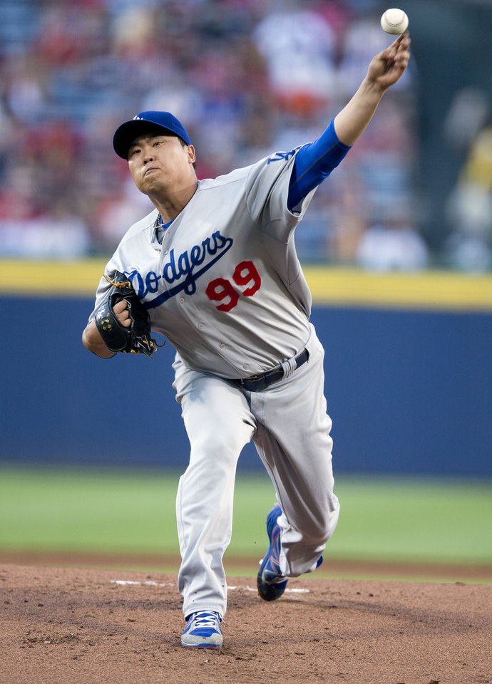 Photo - Los Angeles Dodgers starting pitcher Hyun-Jin Ryu (99) works in the first inning of a baseball game against the Atlanta Braves  Wednesday, Aug. 13, 2014, in Atlanta. (AP Photo/John Bazemore)
