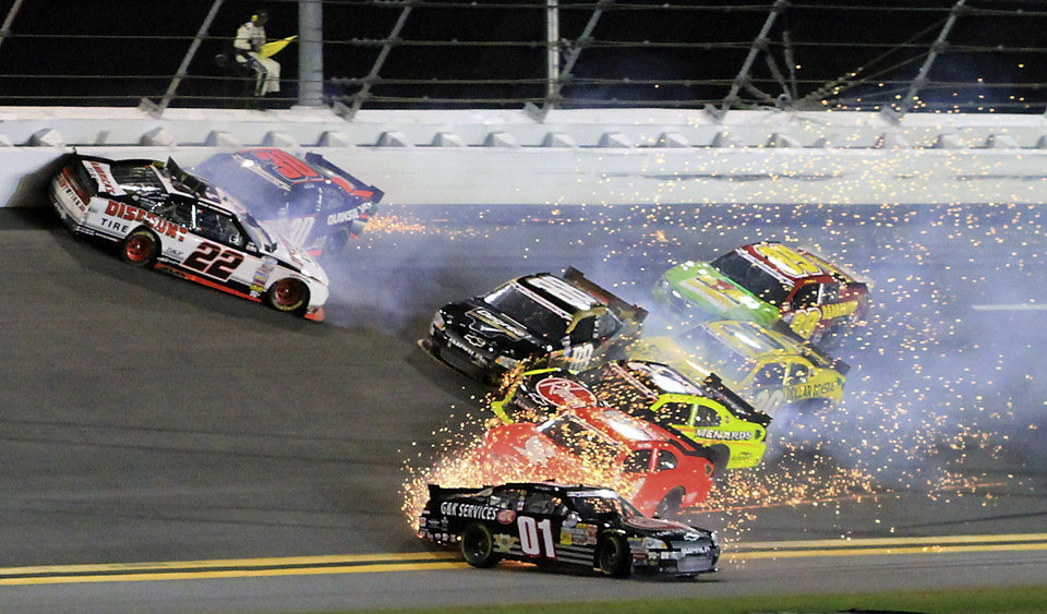 Brad Keselowski (22), James Buescher (30), Mike Wallace (01) and others get caught up in a wreck in Turn 2 during the Nationwide Series NASCAR auto race at Daytona International Speedway, Friday, July 6, 2012, in Daytona Beach, Fla. (AP Photo/Mike Troxell)