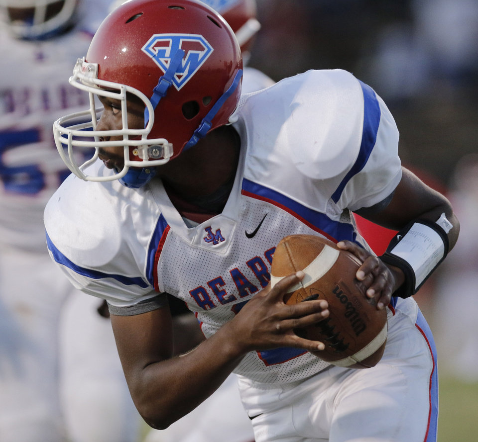 JM Kaleel Bowden hits the corner during the high school football game of John Marshall at Star Spencer, Thursday, September 26, 2013. Photo by Doug Hoke, The Oklahoman