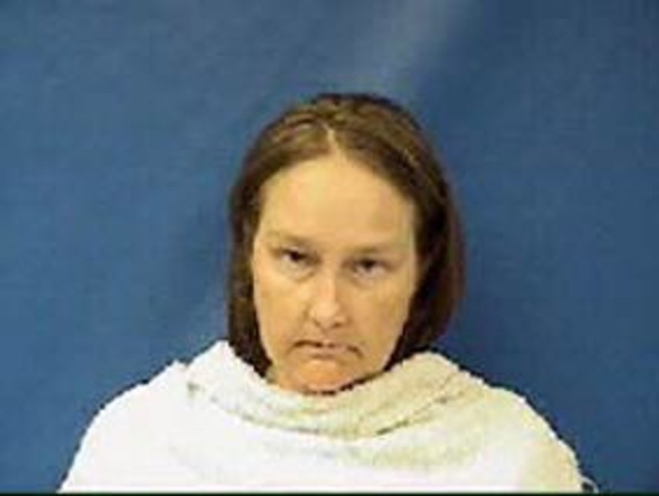 Photo - Kim Williams, wife of former Kaufman County justice of the peace Eric Williams, is seen in an undated photo provided by the Kaufman County Sheriff. Kim Williams was charged with capital murder after confessing to her involvement in the three shooting deaths of the local district attorney, his wife and an assistant prosecutor, authorities said Wednesday, April 17, 2013. Williams was arrested early Wednesday, a day after she told investigators that she and her husband were involved in the shootings of the Kaufman County district attorney, his wife and one of his prosecutors, according to documents in the case. Kaufman County District Attorney Mike McLelland and assistant prosecutor Mark Hasse prosecuted Eric Williams last year for theft of three computer monitors. Williams was convicted and sentenced to probation. He also lost his elected position as justice of the peace and his law license. (AP Photo/Kaufman County Sheriff)