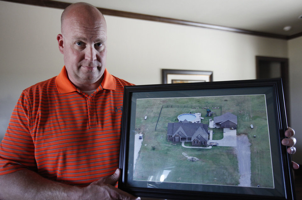 Photo - Chad Brown shows an areal photo taken of his home less than a year before it was destroyed in the May 24, 2011 EF5 tornado,    David McDaniel - The Oklahoman