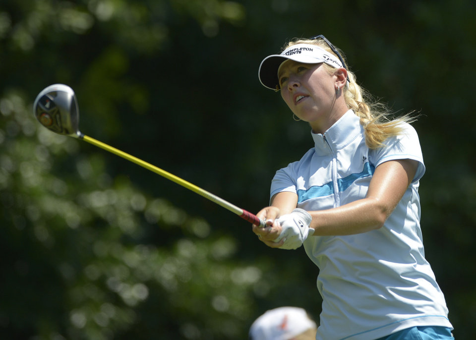 Photo - Jessica Korda watches the flight of her tee shot on the fifth hole during the second round of the Airbus LPGA Classic golf tournament at Magnolia Grove on Friday, May 23, 2014, in Mobile, Ala. (AP Photo/G.M. Andrews)