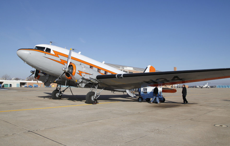 Photo - A DC-3 that is on the National Register of Historic Places prepares to take off from the Mike Monroney Center at Will Rogers World Airport on Thursday. Photo by Paul Hellstern, The Oklahoman  Paul Hellstern