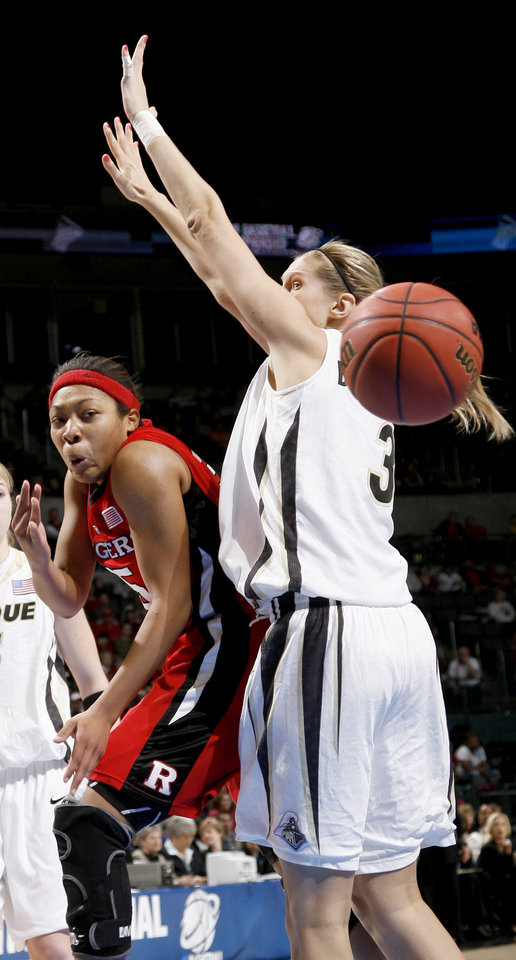 Rurgers\' Brittany Ray passes the ball around Purdue\'s Natasha Bogdanova during the NCAA women\'s basketball tournament game between Rutgers and Purdue at the Ford Center in Oklahoma City, Sunday, March 29, 2009. PHOTO BY BRYAN TERRY, THE OKLAHOMAN