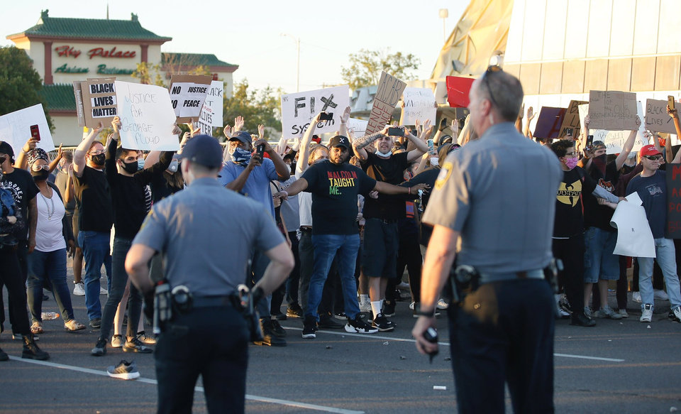 Photo - Oklahoma City Police respond to protesters Saturday, May 30, 2020, near NW 23rd and Classen in Oklahoma City. Photo by Bryan Terry
