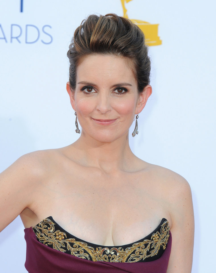 FILE - In this Sept. 23, 2012 file photo, actress Tina Fey arrives at the 64th Primetime Emmy Awards at the Nokia Theatre, in Los Angeles. The Hollywood Foreign Press Association, dick clark productions and NBC announced Monday, Oct. 15, 2012, that Tina Fey and Amy Poehler, have signed on to host the 70th annual ceremony after British comedian Ricky Gervais\' three-year reign as the ceremony\'s acerbic master of ceremonies. The Golden Globes are set to air on NBC on Jan. 13, 2013. (Photo by Jordan Strauss/Invision/AP, File)