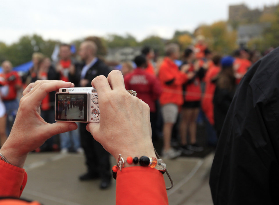 A fan takes pictures during the walk before the college football game between Oklahoma State University (OSU) and the University of Kansas (KU) at Memorial Stadium in Lawrence, Kan., Friday, Oct. 12, 2012. Photo by Sarah Phipps, The Oklahoman