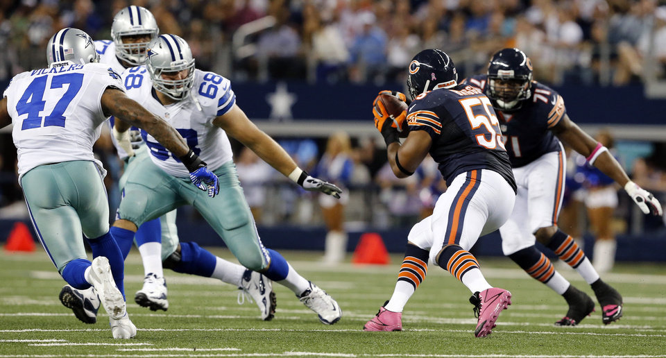 Chicago Bears outside linebacker Lance Briggs (55) intercepts the football against Dallas Cowboys' Doug Free (68), Lawrence Vickers (47) and Tyron Smith (77) during the second half of an NFL football game Monday, Oct. 1, 2012, in Arlington, Texas. The Bears won 34-18. (AP Photo/The Waco Tribune-Herald, Jose Yau)