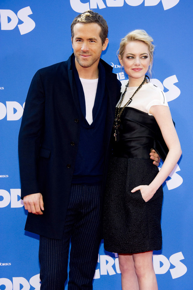 "FILE - This March 10, 2013 file photo shows actors Ryan Reynolds, left, and Emma Stone at ""The Croods"" premiere in New York. Reynolds voices the character Guy and Stone voices the character Eep in the Dreamworks Animation film. (Photo by Charles Sykes/Invision/AP)"