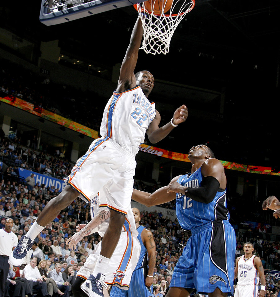 Oklahoma City\'s Jeff Green dunks the ball over Orlando\'s Dwight Howard during the NBA basketball game between the Oklahoma City Thunder and the Orlando Magic at the Ford Center in Oklahoma City, Wednesday, Nov. 12, 2008. BY BRYAN TERRY, THE OKLAHOMAN
