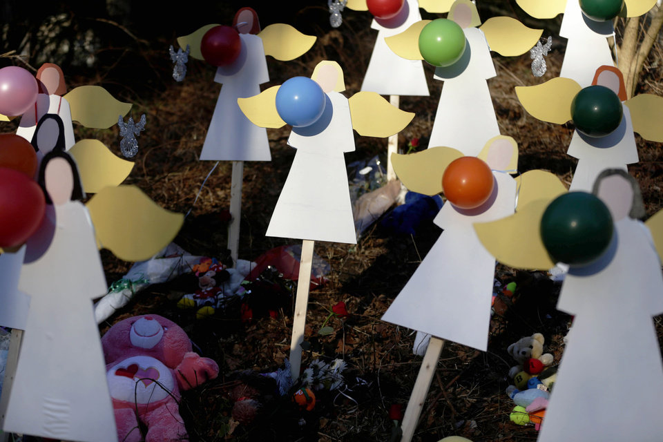 Wooden angels are displayed as part of memorial to shooting victims in Newtown, Conn., Thursday, Dec. 20, 2012.  Adam Lanza walked into Sandy Hook Elementary School in Newtown, Dec. 14, and opened fire, killing 26 people, including 20 children, before killing himself. (AP Photo/Seth Wenig)