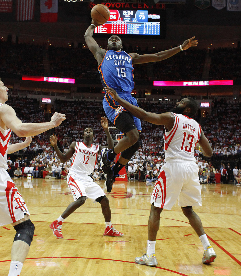 Oklahoma City's Reggie Jackson (15) goes to the basket past Houston's Patrick Beverley (12) and James Harden (13) during Game 3 in the first round of the NBA playoffs between the Oklahoma City Thunder and the Houston Rockets at the Toyota Center in Houston, Texas, Sat., April 27, 2013. Oklahoma City won 104-101. Photo by Bryan Terry, The Oklahoman