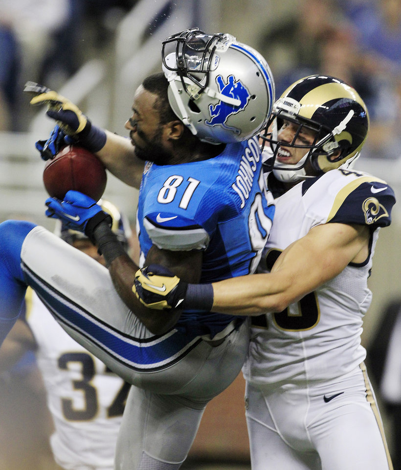 Photo -   St. Louis Rams strong safety Craig Dahl (43) knocks off the helmet of Detroit Lions wide receiver Calvin Johnson (81) after Johnson's 51-yard reception during the second quarter of an NFL football game in Detroit, Sunday, Sept. 9, 2012. (AP Photo/Carlos Osorio)