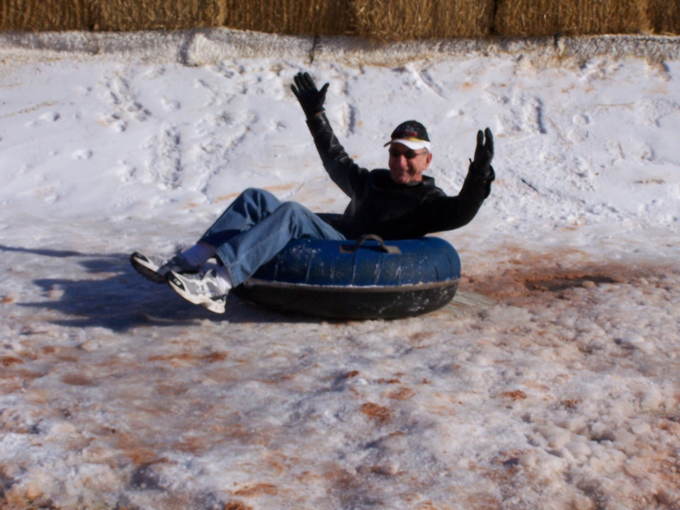 Snowtubing is for all ages!  71 year old grandfather, Wayne Callahan enjoys snowtubing with his grandkids.<br/><b>Community Photo By:</b> Cindi Tennison<br/><b>Submitted By:</b> Cindi , Bethany