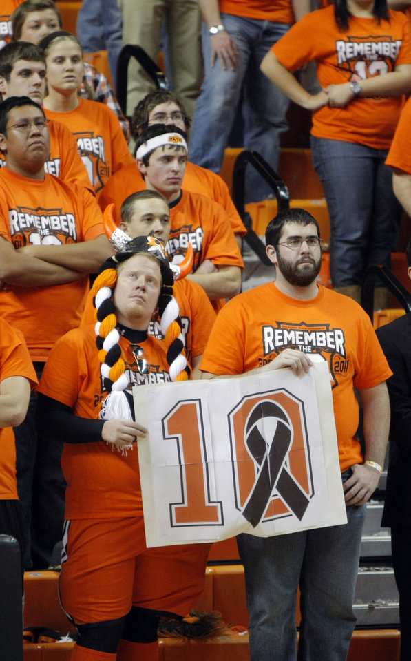 Fans watch a halftime ceremony honoring the 10 men killed in the 2001 plane crash at the basketball game between Oklahoma State and Texas, Wednesday, Jan. 26, 2011, at Gallagher-Iba Arena in Stillwater, Okla. Photo by Sarah Phipps, The Oklahoman
