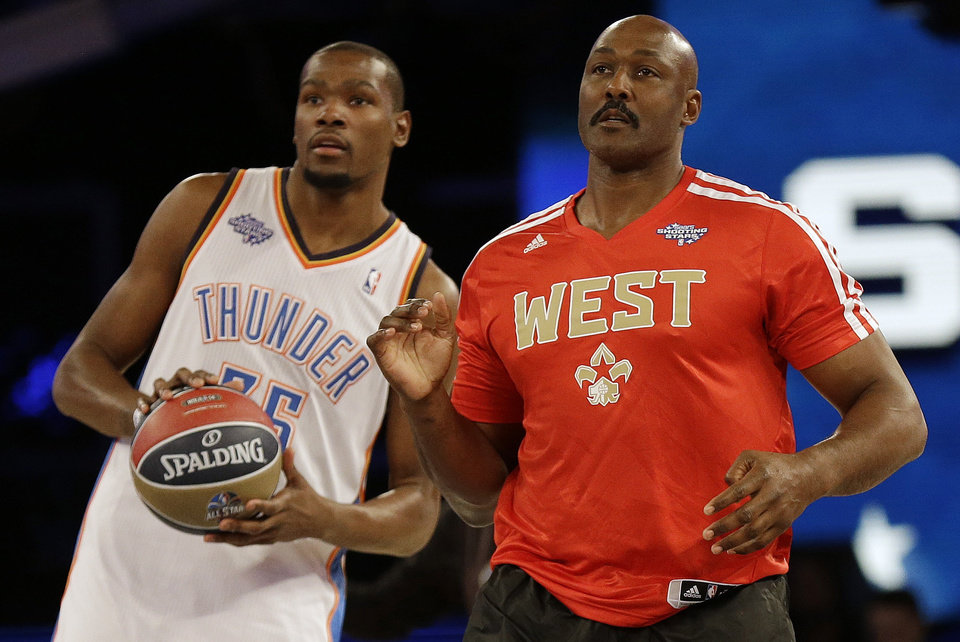 Photo - Oklahoma City Thunder Kevin Durant, left and Former player Karl Malone watch a shot on goal during the skills competition at the NBA All Star basketball game, Saturday, Feb. 15, 2014, in New Orleans. (AP Photo/Gerald Herbert)