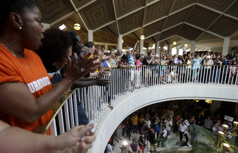 Photo - Protestors and supporters gather around the balcony overlooking the House and Senate floors during a demonstration at the state legislature in Raleigh, N.C., Monday, June 17, 2013. Supporters of what the group calls