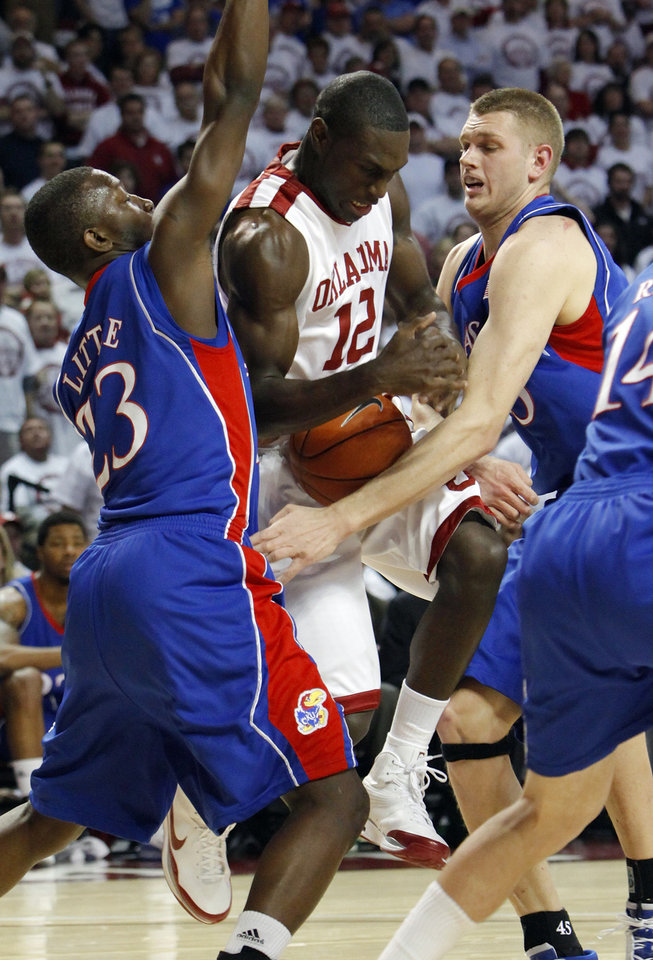 OU's Juan Pattillo (12) gets caught between KU's Mario Little (23) and Cole Aldrich (45) in the first half of the men's college basketball game between Kansas and Oklahoma at the Lloyd Noble Center in Norman, Okla., Monday, February 23, 2009. BY NATE BILLINGS, THE OKLAHOMAN