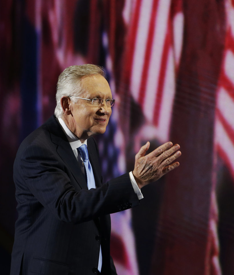 Photo - Senate Majority Leader Harry Reid of Nevada waves to delegates after his speech at the Democratic National Convention in Charlotte, N.C., on Tuesday, Sept. 4, 2012. (AP Photo/Lynne Sladky)  ORG XMIT: DNC443