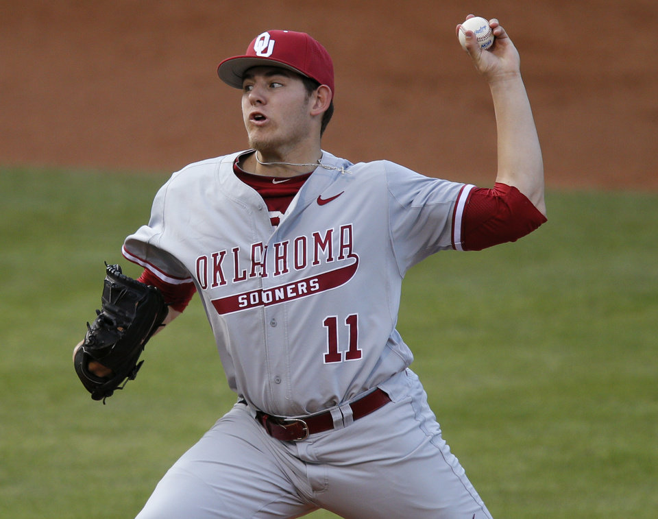 Photo - OU's Jacob Evans pitches during a Bedlam baseball game between the University of Oklahoma and Oklahoma State University at Chickasaw Bricktown Ballpark in Oklahoma City, Thursday, May 15, 2014. Photo by Bryan Terry, The Oklahoman