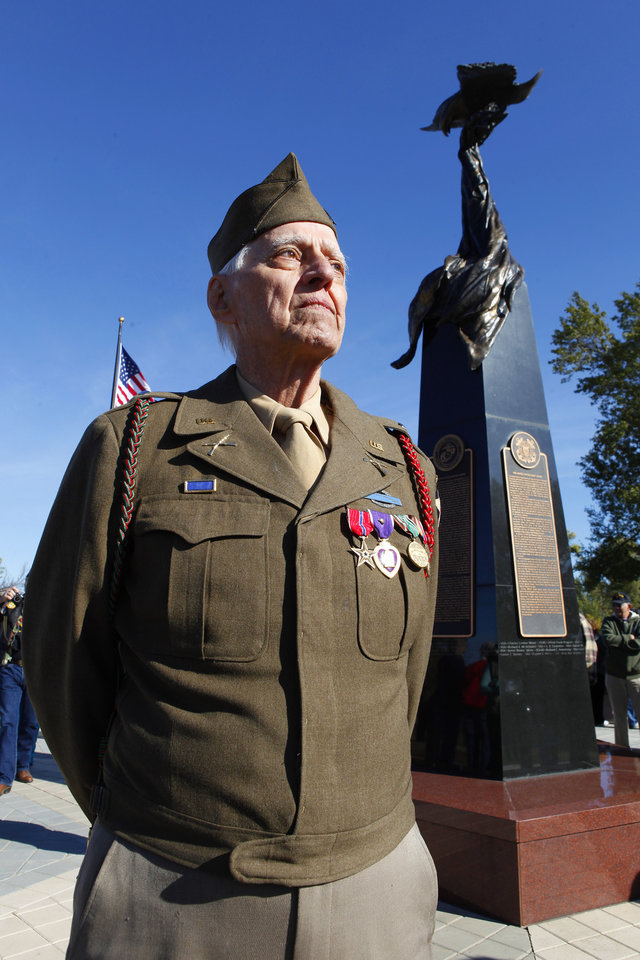 William D. Trumbly, Norman, stands at the Cleveland County Veterans Memorial wearing his World War II uniform with his Bronze Star and Purple Heart medals during the Veterans Day ceremony in Norman Friday, Nov. 11, 2011. Trumbly was a 1st Lieutenant in the 2nd Infantry in Europe and was wounded at the Battle of the Bulge. Photo by Paul B. Southerland, The Oklahoman