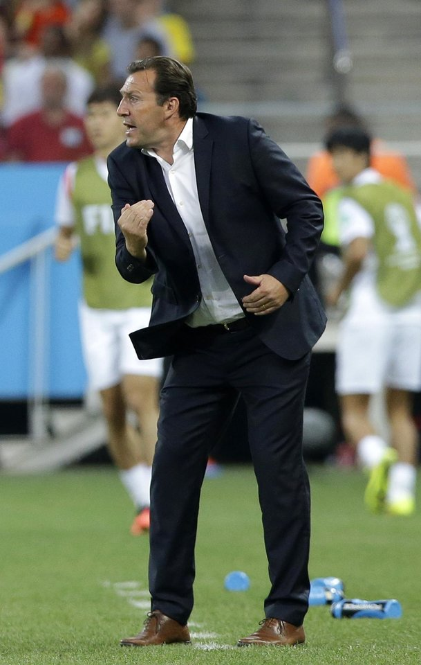 Photo - Belgium's head coach Marc Wilmots directs his players during the group H World Cup soccer match between South Korea and Belgium at the Itaquerao Stadium in Sao Paulo, Brazil, Thursday, June 26, 2014. (AP Photo/Lee Jin-man)