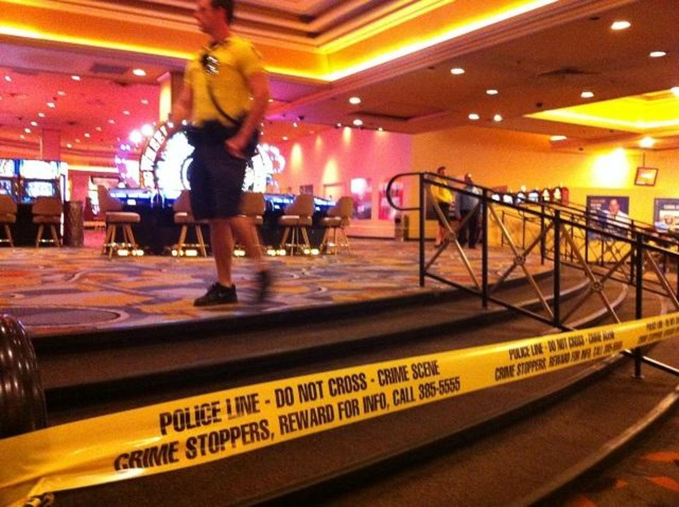 Photo - Security personnel cordon off the scene of an early morning shooting at Bally's Hotel-Casino on the Las Vegas Strip on Monday, Oct. 21, 2013. Las Vegas police said a man opened fire about 5:45 a.m. in the casino at 3645 Las Vegas Boulevard South, near Flamingo Road, after he was refused entrance to Drai's After Hours nightclub. The shooting left one dead and two others injured. (AP Photo/Las Vegas Review-Journal, Mike Blasky)  LOCAL TV OUT; LOCAL INTERNET OUT; LAS VEGAS SUN OUT