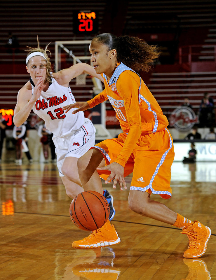 Photo - Tennessee guard Meighan Simmons (10) drives the ball past Mississippi guard Gracie Frizzell (12) during the first half of an NCAA college basketball game in Oxford, Miss., Thursday, Feb. 6, 2014. (AP Photo/Thomas Graning)