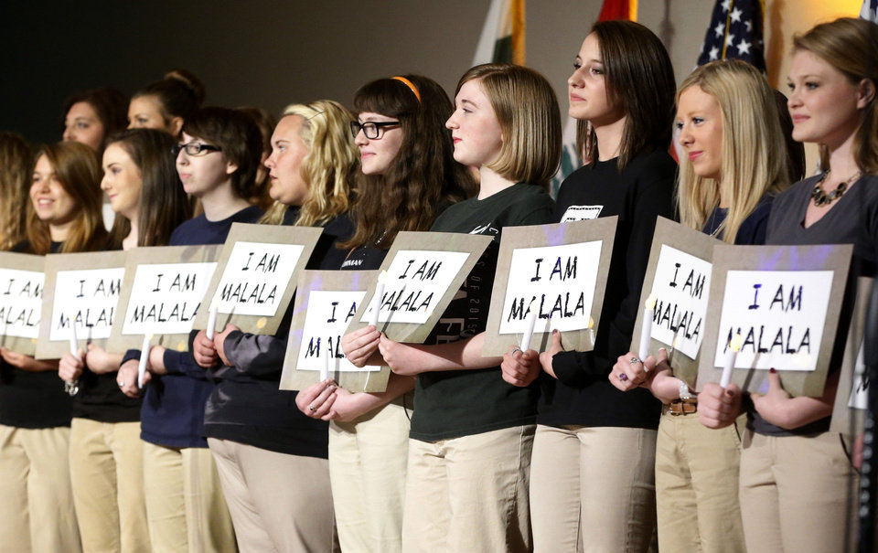 Photo - Girls from 33 Oklahoma communities hold signs that read