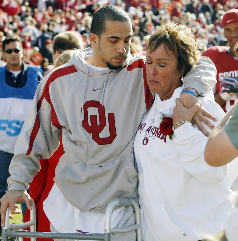 OU's Corey Wilson, left, stands with his mother, Wendy Wilson, before the Bedlam college football game between the University of Oklahoma Sooners (OU) and the Oklahoma State University Cowboys (OSU) at the Gaylord Family --Oklahoma Memorial Stadium on Saturday, Nov. 28, 2009, in Norman, Okla. Before the game Corey Wilson walked on Owen Field for the first time at a game since a car wreck left him partially paralyzed in February.   Photo by Nate Billings, The Oklahoman