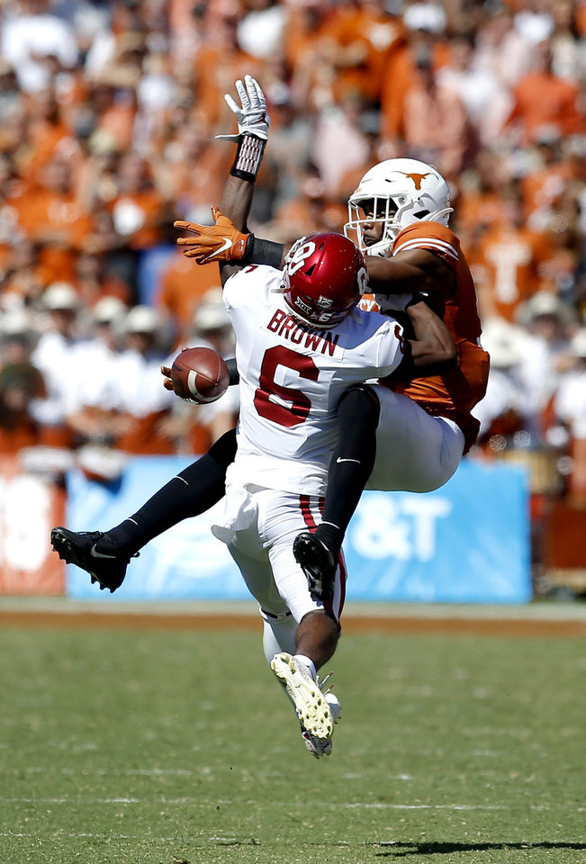 Photo - Oklahoma's Tre Brown (6) breaks up a pass intended for Texas wide receiver Brennan Eagles (13) in the third quarter during the Red River Showdown college football game between the University of Oklahoma Sooners (OU) and the Texas Longhorns (UT) at Cotton Bowl Stadium in Dallas, Saturday, Oct. 12, 2019. OU won 34-27. [Sarah Phipps/The Oklahoman]