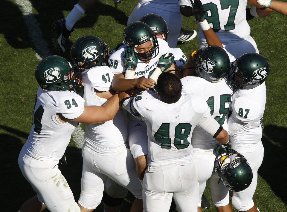 Photo -   Sacramento State place kicker Edgar Castaneda, center, celebrates with teammates after making the winning field goal against Colorado in the fourth quarter of their NCAA college football game in Boulder, Colo., Saturday, Sept. 8, 2012. Sacramento State won 30-28. (AP Photo/David Zalubowski)