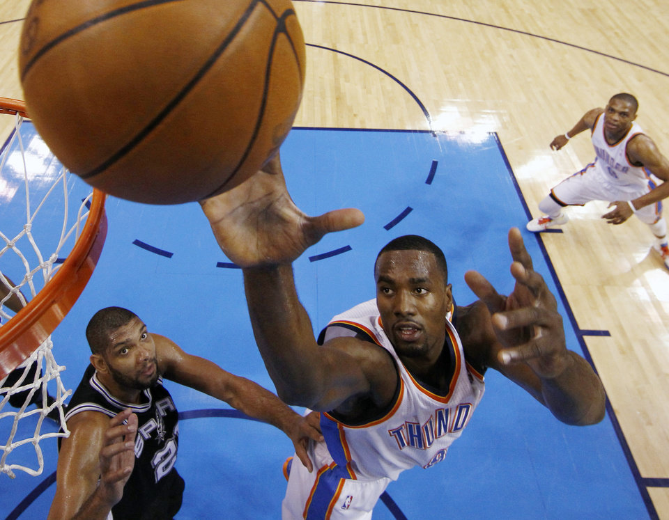 Oklahoma City Thunder power forward Serge Ibaka (9), from the Republic of Congo, shoots as San Antonio Spurs center Tim Duncan (21) watches during the first half of Game 6 in the NBA basketball Western Conference finals, Wednesday, June 6, 2012, in Oklahoma City. (AP Photo/Jim Young, Pool)