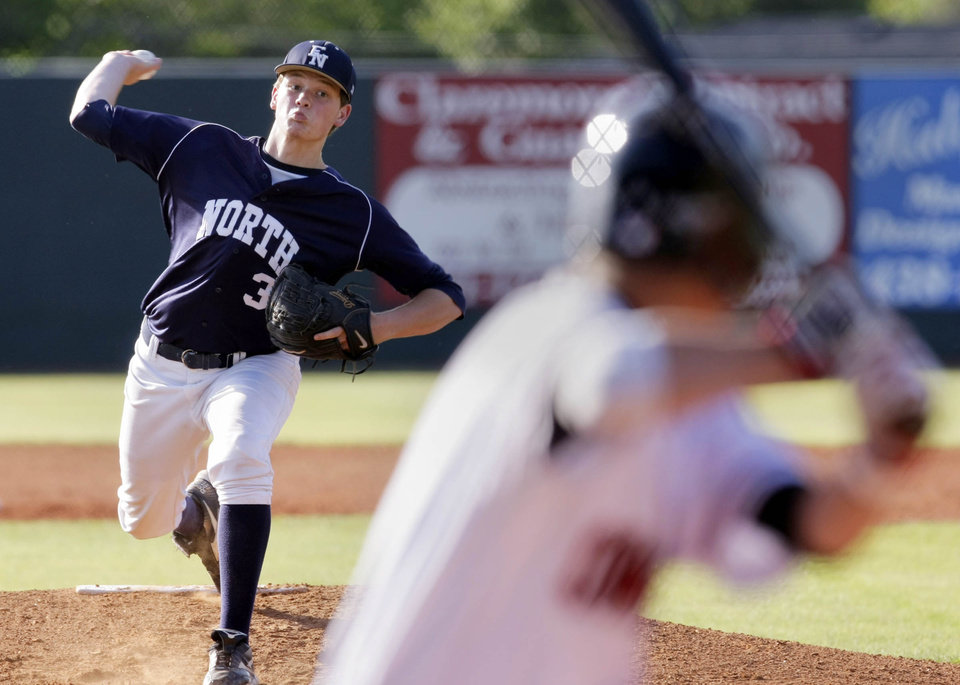 Photo - Edmond North pitcher Kyle Stephens delivers against Owasso in their first round game in the OSSAA 6A State Baseball Championship in Claremore, OK, May 10, 2012. MICHAEL WYKE/Tulsa World
