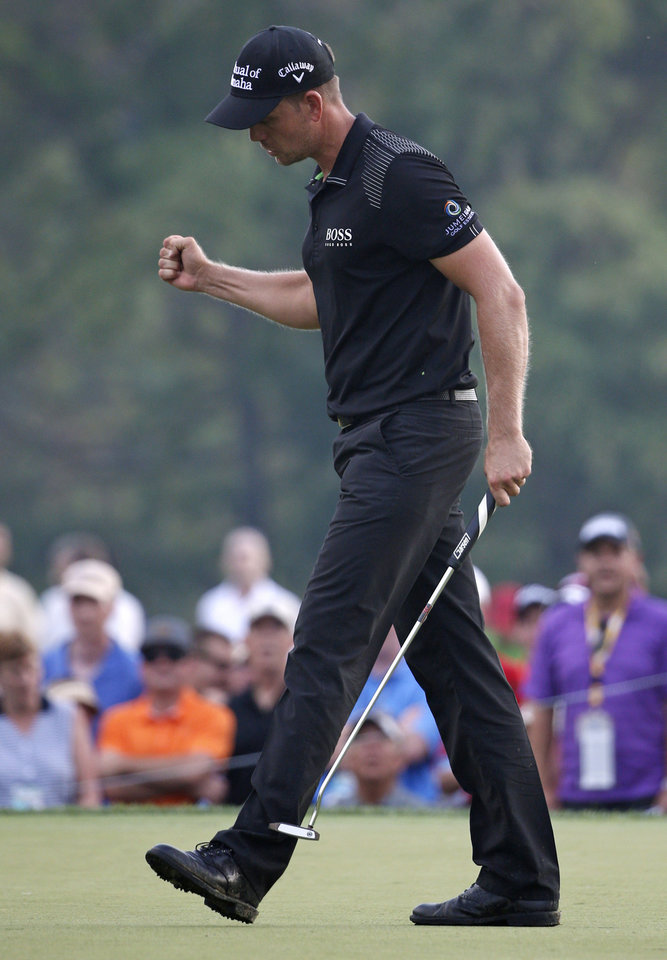 Photo - Henrik Stenson, of Sweden, celebrates a par on the 12th hole during the final round of the PGA Championship golf tournament at Valhalla Golf Club on Sunday, Aug. 10, 2014, in Louisville, Ky. (AP Photo/Mike Groll)