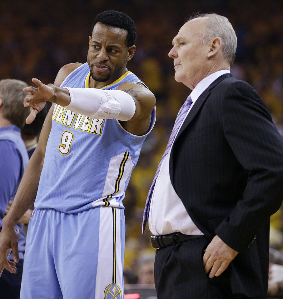 Denver Nuggets guard Andre Iguodala (9) talks with head coach George Karl during the first half of Game 4 in a first-round NBA basketball playoff series against the Golden State Warriors, Sunday, April 28, 2013, in Oakland, Calif. (AP Photo/Ben Margot)