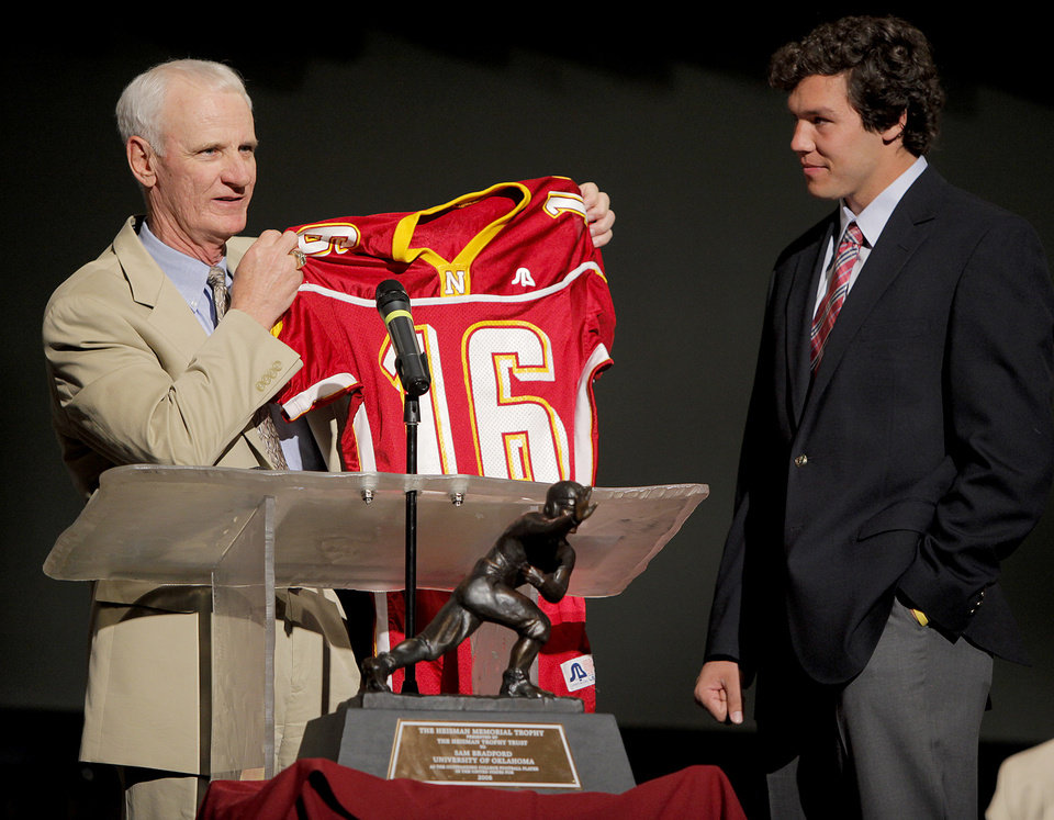 Photo - JERSEY RETIREMENT: Putnam City North football coach Bob Wilson holds up Sam Bradford's high school jersey beside University of Oklahoma (OU) college football quarterback Sam Bradford during a ceremony to honor Bradford and retire his jersey at Putnam City North High School in Oklahoma City, Friday, April 24, 2009. Photo by Bryan Terry, The Oklahoman ORG XMIT: KOD