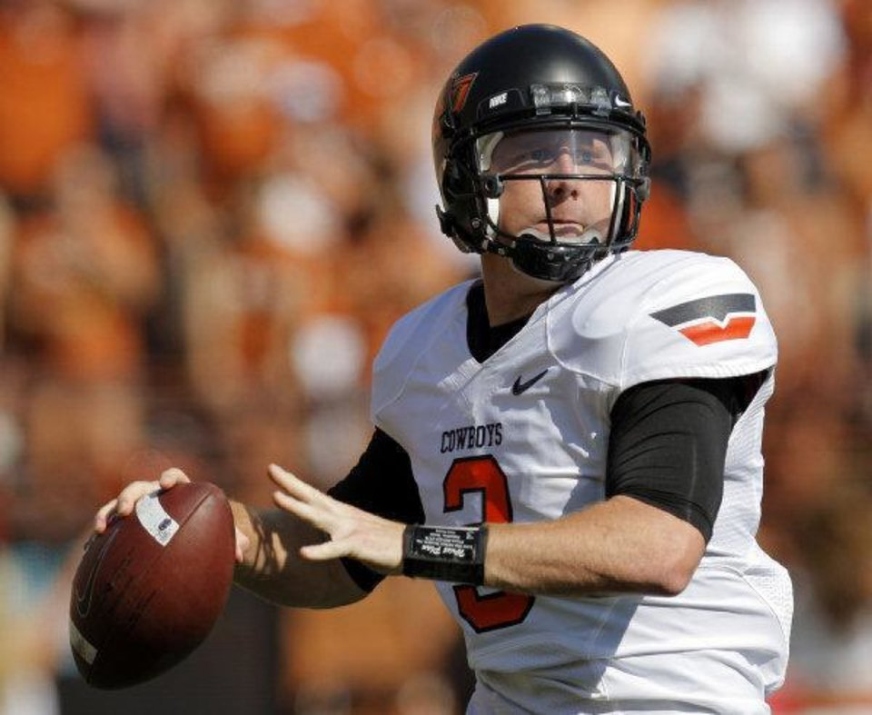 Photo - Oklahoma State's Brandon Weeden (3) passes in the first half during a college football game between the Oklahoma State University Cowboys (OSU) and the University of Texas Longhorns (UT) at Darrell K Royal-Texas Memorial Stadium in Austin, Texas, Saturday, Oct. 15, 2011. Photo by Nate Billings, The Oklahoman  NATE BILLINGS