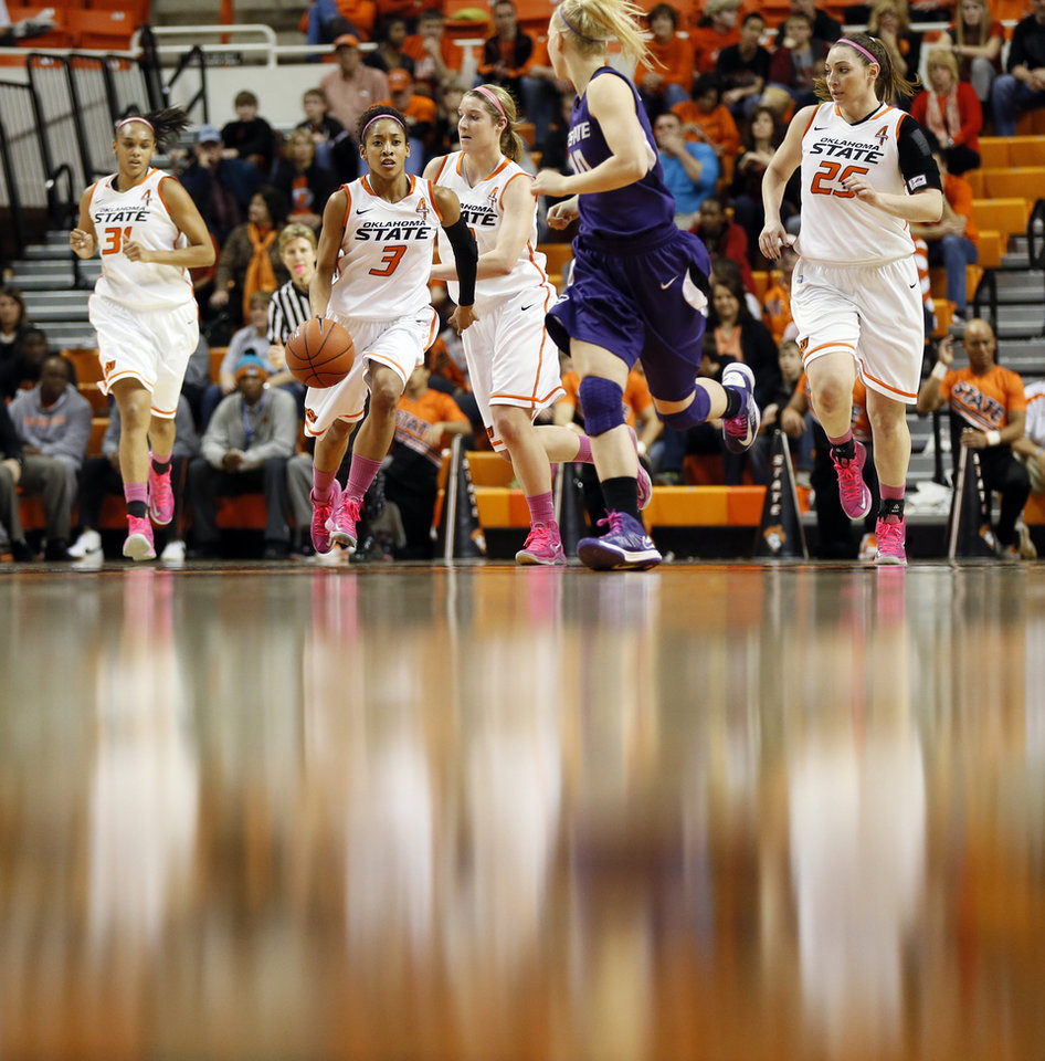 Photo - Oklahoma State's Tiffany Bias (3) leads Cowgirls Kendra Suttles (31), Liz Donohoe (4) and Lindsey Keller (25) on a fast break against Kansas State's Heidi Brown (10) during an NCAA women's basketball game between Oklahoma State University (OSU) and Kansas State at Gallagher-Iba Arena in Stillwater, Okla., Saturday, Feb. 16, 2013. Photo by Nate Billings, The Oklahoman