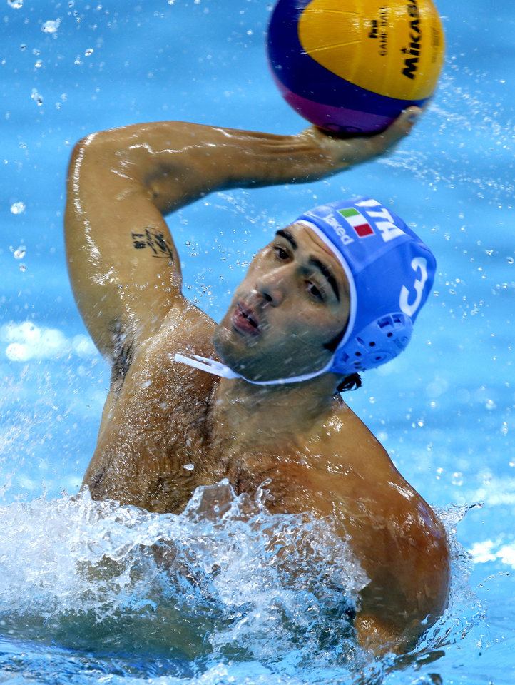 Italy's Niccolo Gitto shoots against Croatia during the men's water polo gold medal match at the 2012 Summer Olympics, Sunday, Aug. 12, 2012, in London. (AP Photo/Julio Cortez)