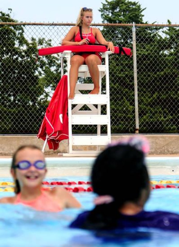 Photo -  Putnam City North senior Elise Kraft works her rotation as a lifeguard at Will Rogers Family Aquatic Center in Oklahoma City. [Photo by Chris Landsberger, The Oklahoman]