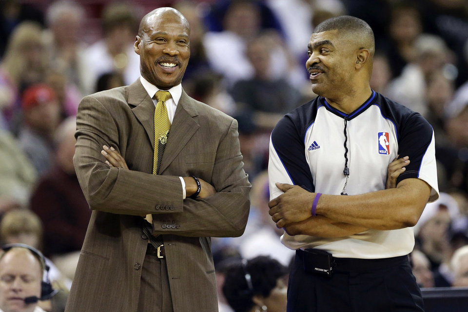 Photo - Cleveland Cavaliers head coach Byron Scott, left, talks with official Tony Brothers during a break in an NBA basketball game against the   Sacramento Kings in Sacramento, Calif., Monday, Jan. 14, 2013. (AP Photo/Rich Pedroncelli)