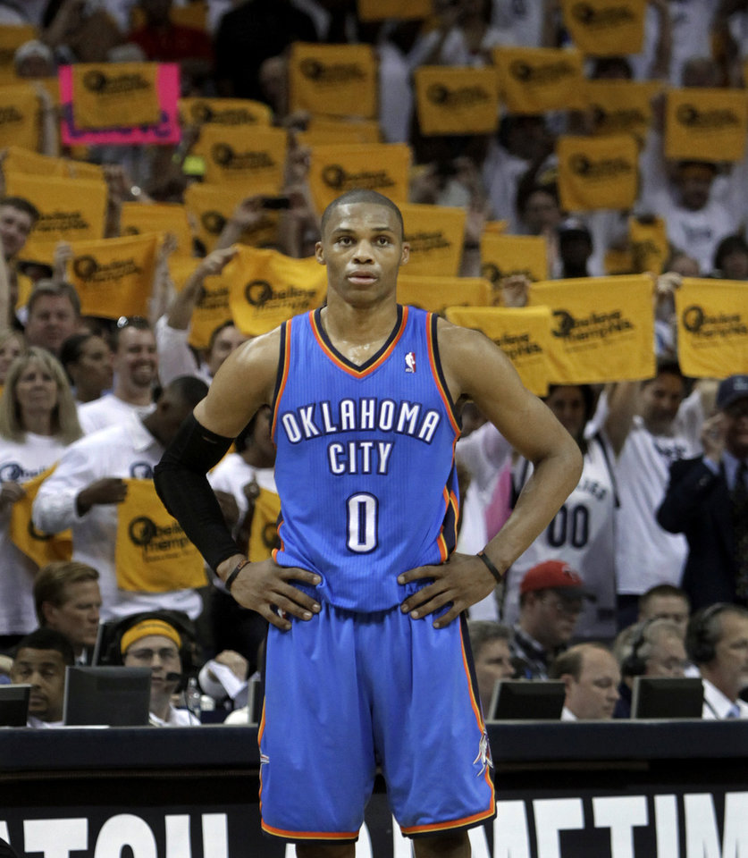 Photo - Oklahoma City Thunder guard Russell Westbrook (0) waits for play to resume as Memphis Grizzlies fans wave towels during the overtime period of Game 3 in a second-round NBA basketball series on Saturday, May 7, 2011, in Memphis, Tenn. The Grizzlies won 101-93 in overtime to take a 2-1 lead in the series. Westbrook scored 13 points and 12 assists. (AP Photo/Lance Murphey)