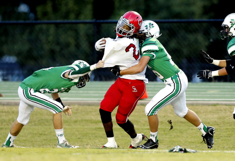 Photo - McGuinness Gray Gochenour is tackled on a kick return as the Carl Albert Titans play the Bishop McGuinness Irish on Friday, Oct. 4, 2013 in Oklahoma City, Okla.  Photo by Steve Sisney, The Oklahoman