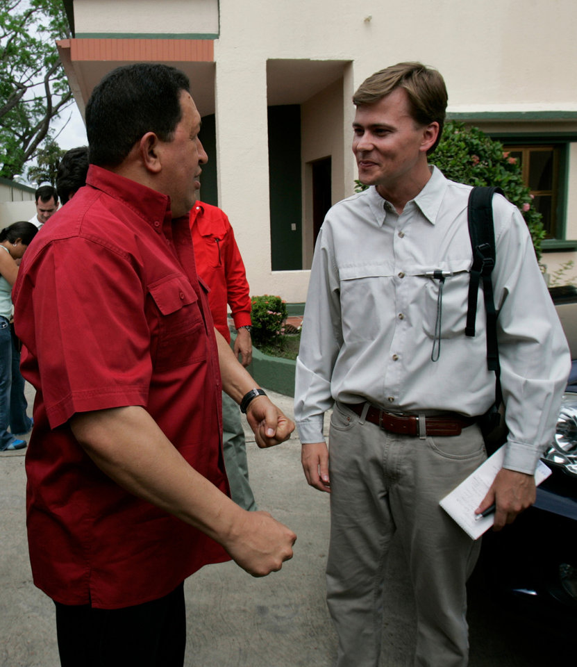 In this June 10, 2007 photo, Venezuela\'s President Hugo Chavez speaks with AP reporter Ian James in San Fernando de Apure, Venezuela. During more than eight years covering Venezuela, James says he has gained more street smarts, become a tougher, more resourceful reporter and developed a deep affection for Venezuela, a country where events often collide in unpredictable and dramatic ways and where a wide gap frequently separates the reality on the street from the socialist-inspired dreams that Chavez has instilled in his followers. (AP Photo/Fernando Llano)