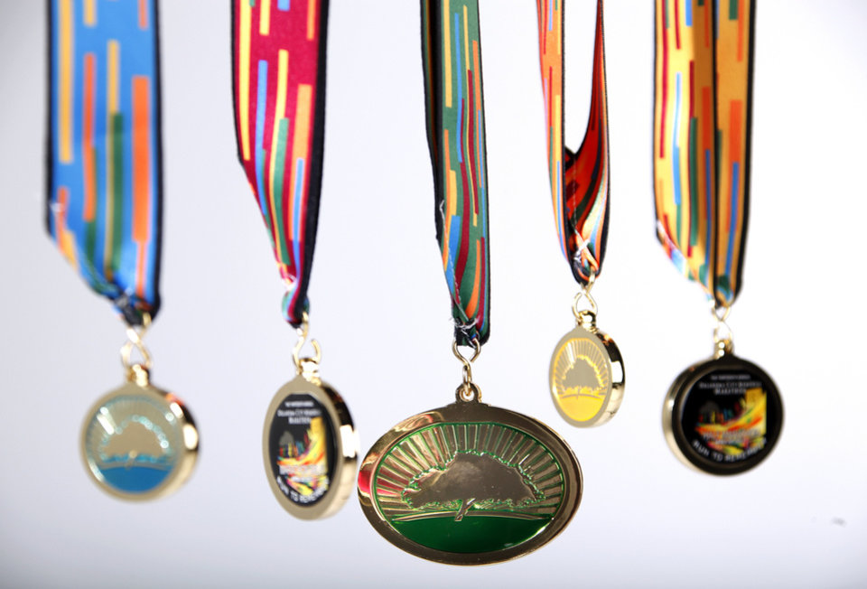 Photo - The most dramatic change this year is the complete makeover to the Oklahoma City Memorial Marathon medals.  Photos by Sarah Phipps, The Oklahoman