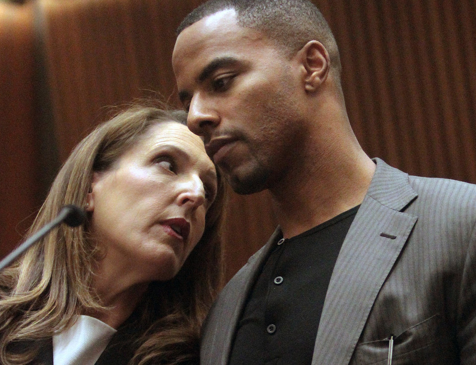 Photo - Former NFL safety Darren Sharper, right, huddles with attorney Blair Berk in Los Angeles Superior Court on Thursday, Feb. 20, 2014, in Los Angeles. Sharper has pleaded not guilty to charges that he drugged and raped two women he met at a West Hollywood night club. (AP Photo/Los Angeles Times, Bob Chamberlin, Pool)